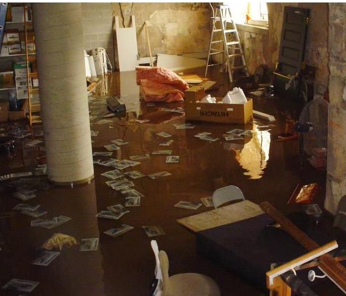 flooded basement with papers and boxes and furniture floating around