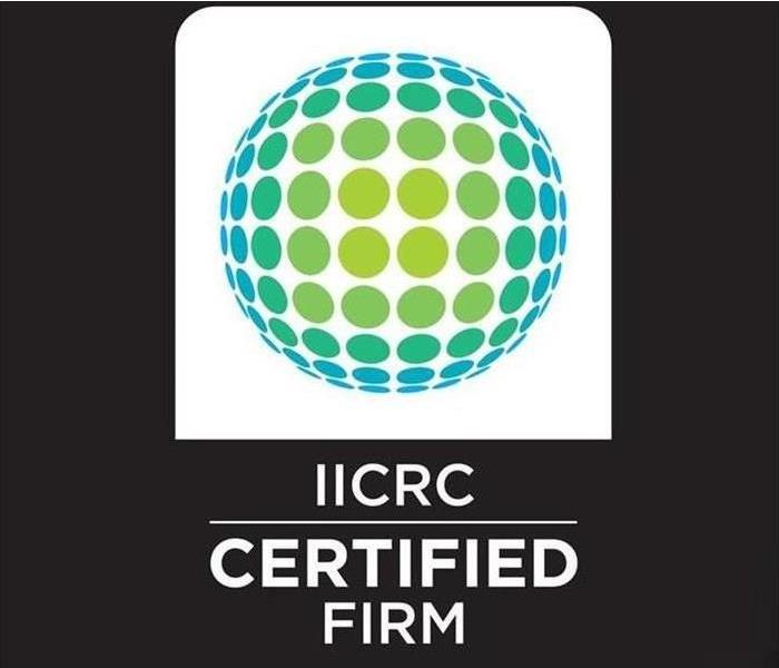 Modern looking Logo of the IICRC with IICRC Certified Firm below it, identifier for an IICRC Certified Firm